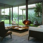 Камина с уникален дизайн е своеобразен център на дневната