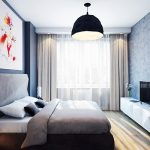 Спалнята е решена в синьо и бежово