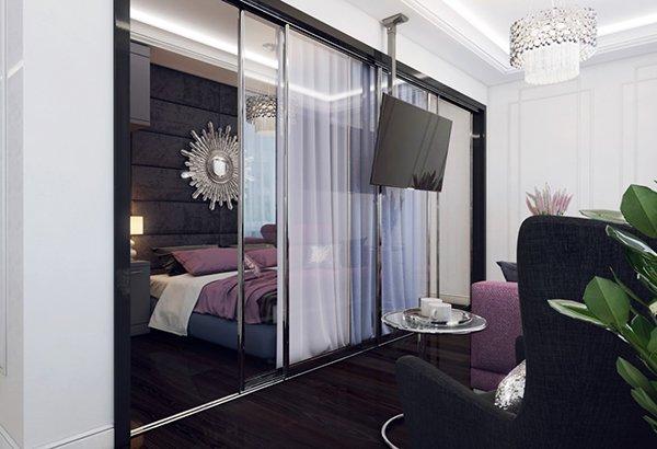 Големи стъклени плъзгащи се прегради отделят мястото за сън от дневния кът